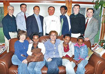 The Stones and the Katz Family with the fund trustees. Back row, left to right – Jack Elicone, Peter Brown, Peter Hunter, Ed Stone, Dawit Katz, Matt Stone, Phil Stone